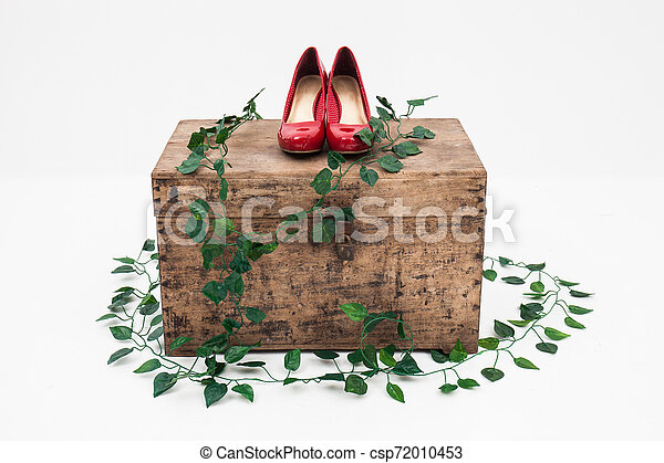 red shoes with box on a white background - csp72010453