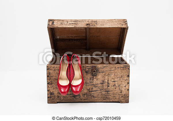 red shoes with box on a white background - csp72010459