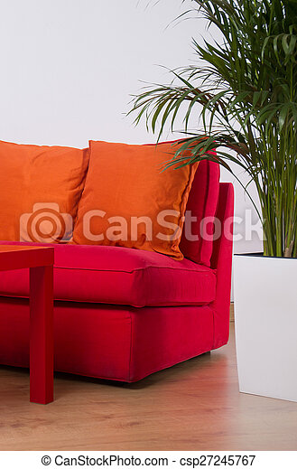 Red Sofa With Orange Cushions In Teen Bedroom Canstock