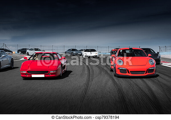 Red sport cars drive on the road - csp79378194