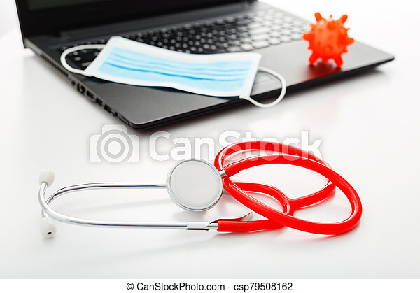 Red Stethoscope, surgical protective mask, model of coronavirus Microscope virus on laptop. Coronavirus covid-19 covid19 prevention. Medicine health care concept. Doctors workplace, doctors appointment - csp79508162