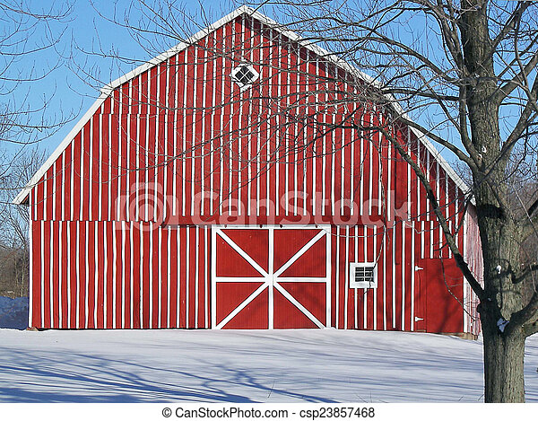 red striped barn in winter - csp23857468