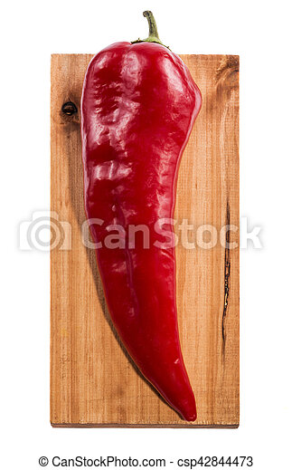 Red sweet pepper on a wooden board - csp42844473