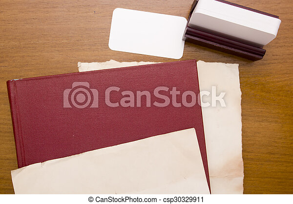 red thick book with business card for placing information