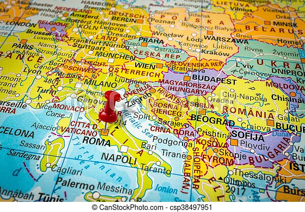 Red thumbtack in a map, pushpin pointing at rome city.