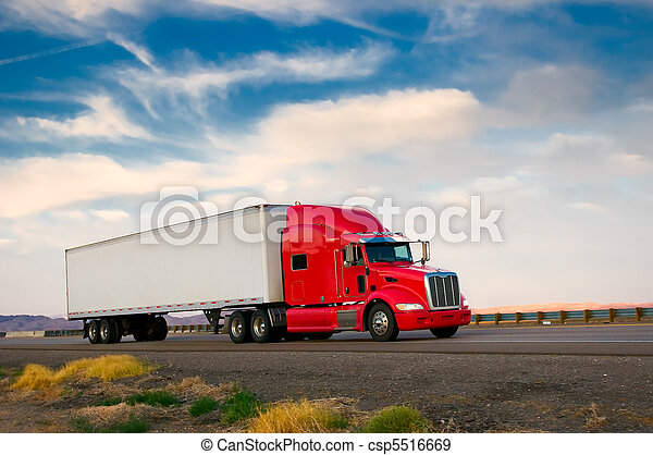 Red truck moving on a highway - csp5516669