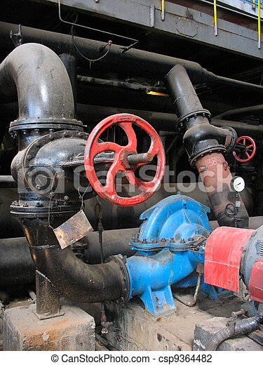 red valve and electric water pumps at power plant - csp9364482