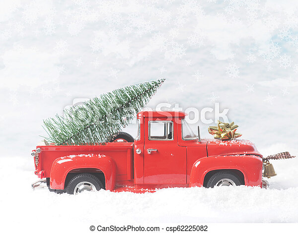 Red vintage truck with Christmas tree - csp62225082