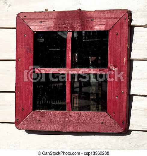 Red window of a old wooden house - csp13360288