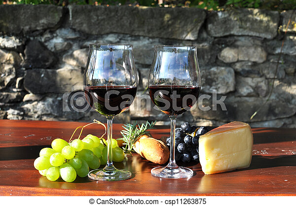 Red wine and grapes - csp11263875