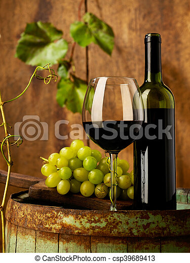 Red wine and grapes - csp39689413