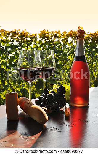Red wine and grapes - csp8690377