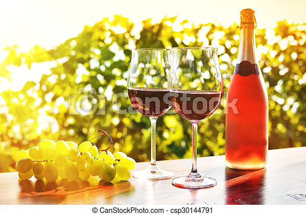 Red wine and grapes - csp30144791