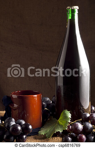 Red Wine Bottle with Grapes - csp6816769