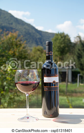 Red wine bottle with wineglass - csp51318401