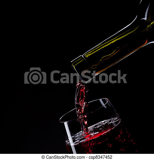 red wine pouring into wine glass isolated on black - csp8347452