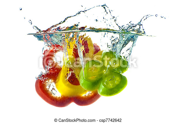 Red, yellow and green abstract pepper splashing in clear blue water - isolated against white background. - csp7742642