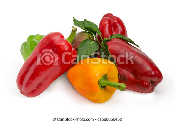 Red, yellow and green bell peppers and twig with leaves - csp68856452