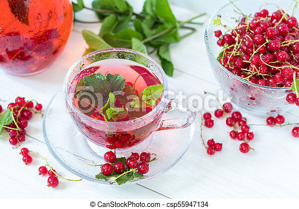 Redcurrant drink in transparent glass carafe and cup - csp55947134