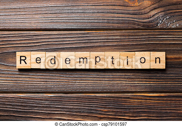 redemption word written on wood block. redemption text on wooden table for your desing, concept - csp79101597