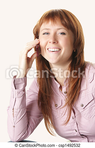 Redhead in pink shirt with mobile - csp1492532