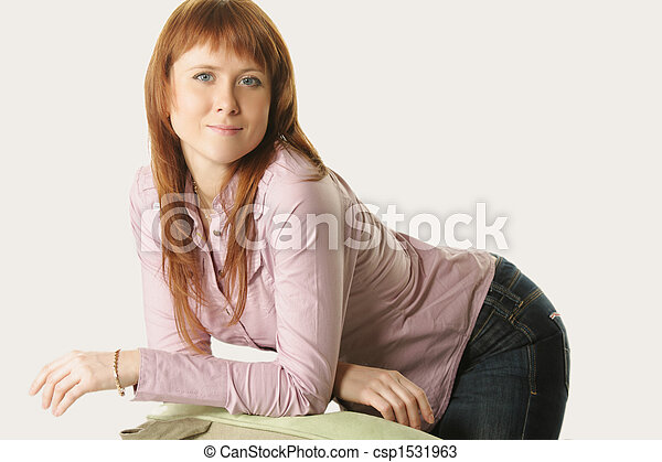 Redhead leaning on chair back - csp1531963