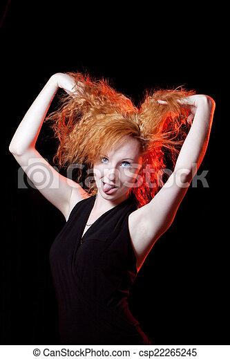 Redhead woman play the fool - csp22265245