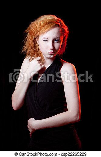 Redhead woman winking - csp22265229