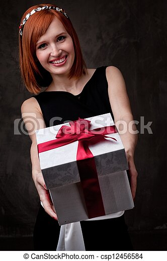 Redhead woman with a gift box. - csp12456584