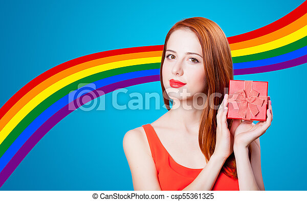 Redhead woman with gif box on blue background - csp55361325