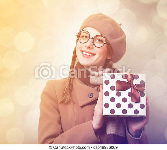 Redhead woman with gift box - csp49936069