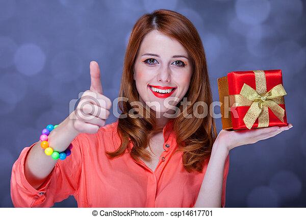 Redhead woman with present box. Bokeh. - csp14617701