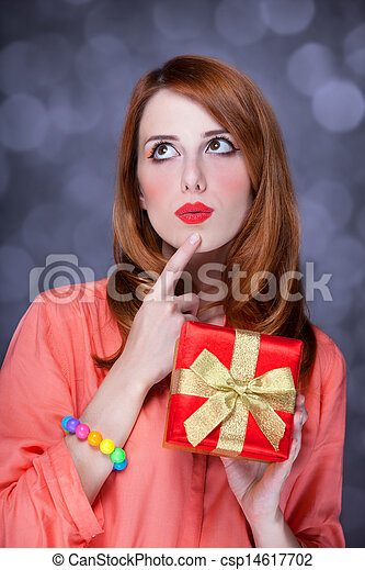Redhead woman with present box. Bokeh. - csp14617702