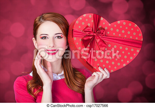 Redhead woman with shape heart box. - csp17027566