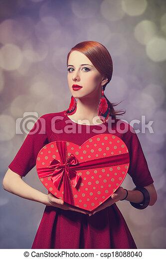 Redhead woman with shape heart box. - csp18088040