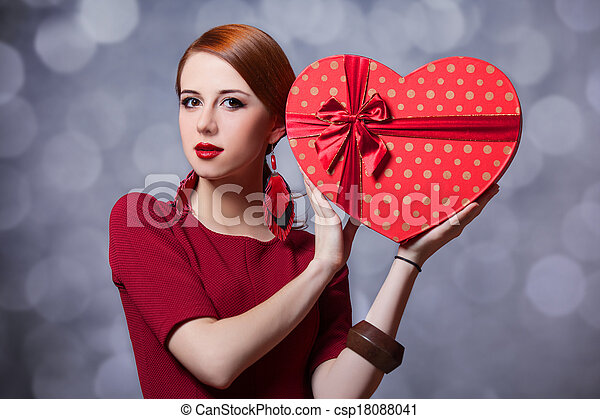 Redhead woman with shape heart box. - csp18088041