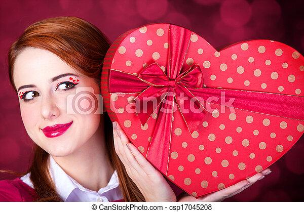 Redhead woman with shape heart box. - csp17045208