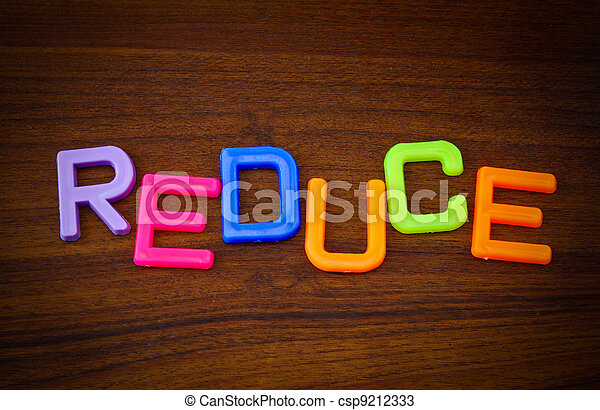 Reduce in colorful toy letters on wood background - csp9212333