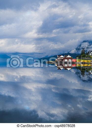 Reflecion on a fjord in Norway - csp48978028