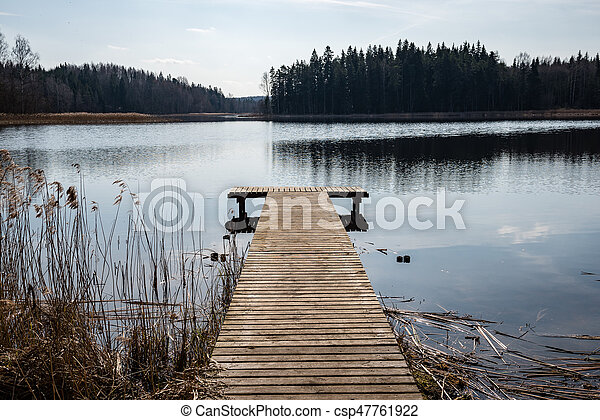 reflection of clouds in the lake with boardwalk - csp47761922