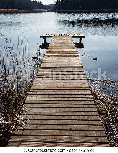reflection of clouds in the lake with boardwalk - csp47761924