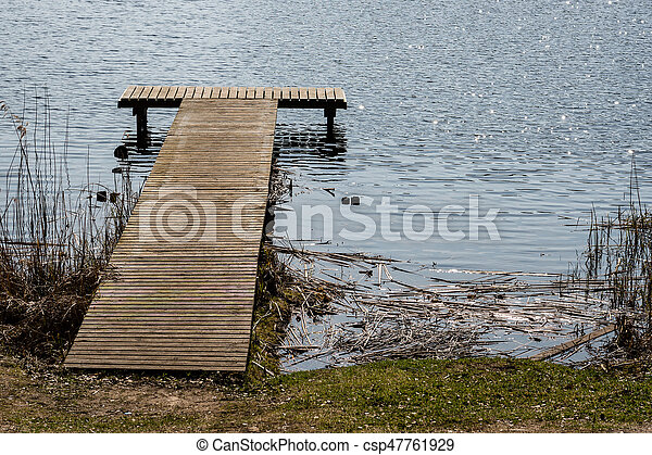 reflection of clouds in the lake with boardwalk - csp47761929