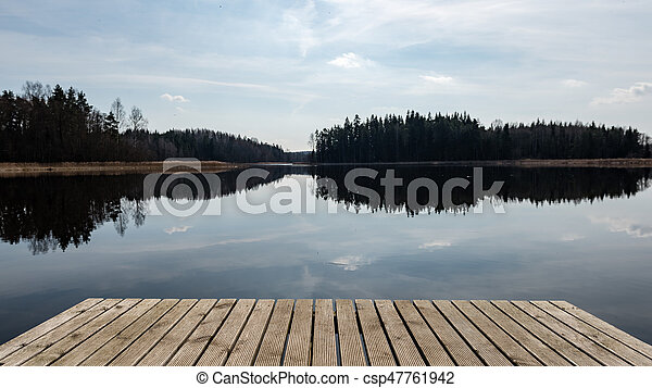 reflection of clouds in the lake with boardwalk - csp47761942