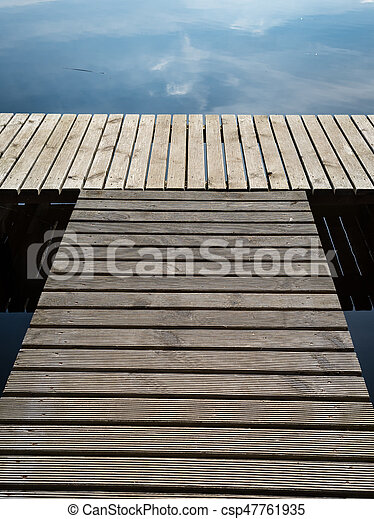reflection of clouds in the lake with boardwalk - csp47761935