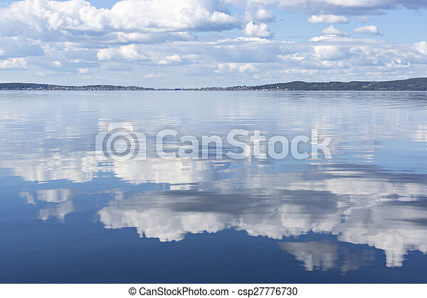 Reflection of clouds on lake water - csp27776730