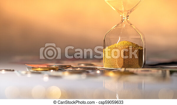 Reflection of hourglass with currency on glowing table. - csp59059633