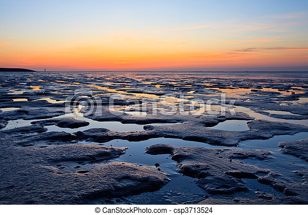 Reflection of the sunset in the ocean - csp3713524