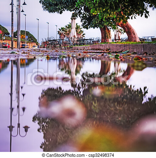reflection on a puddle in hdr - csp32498374
