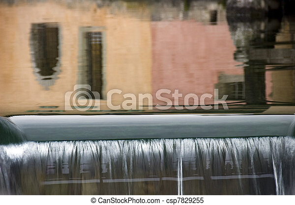 Reflections of colored walls and waterfall in Annecy - csp7829255