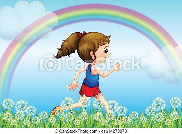 Ein Mädchen mit einem Regenbogen am Himmel - csp14273078